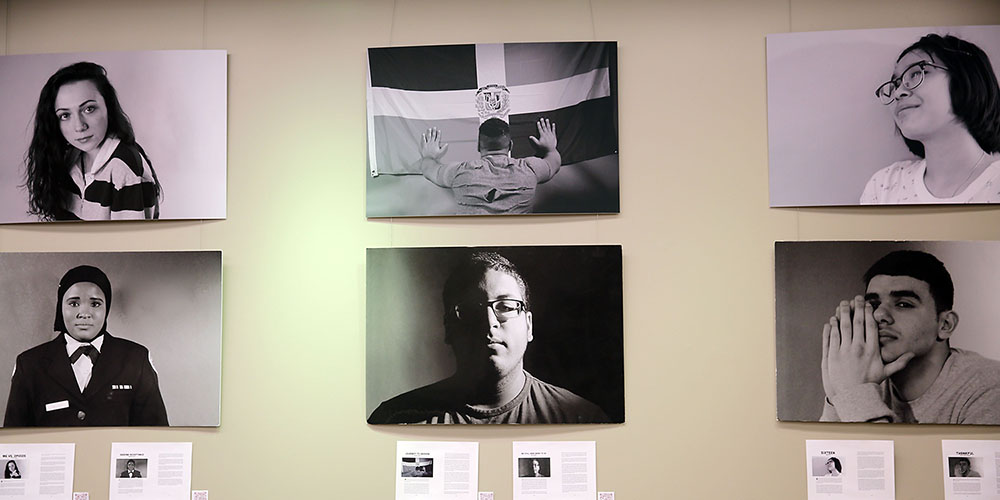 Photos of students on gallery wall