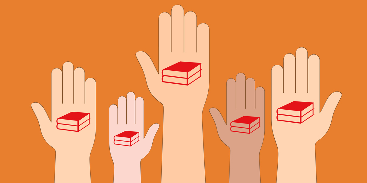 Hands with books in them