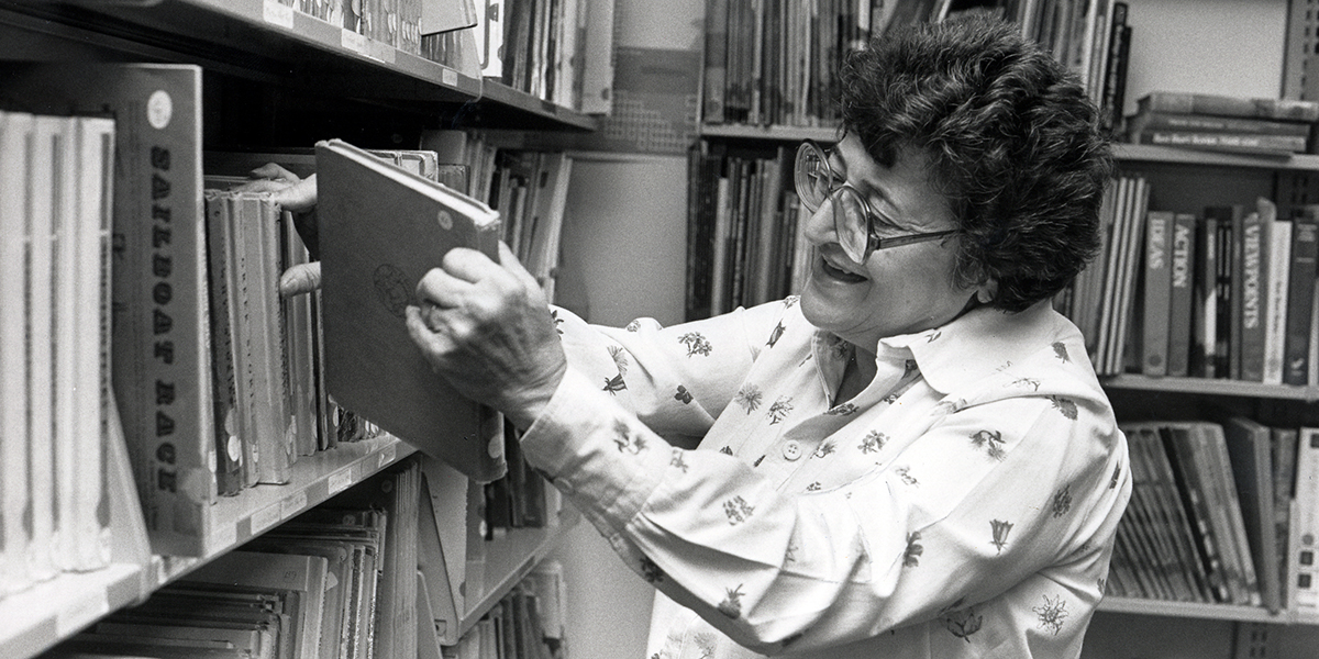 Jeanne Chall in the library stacks