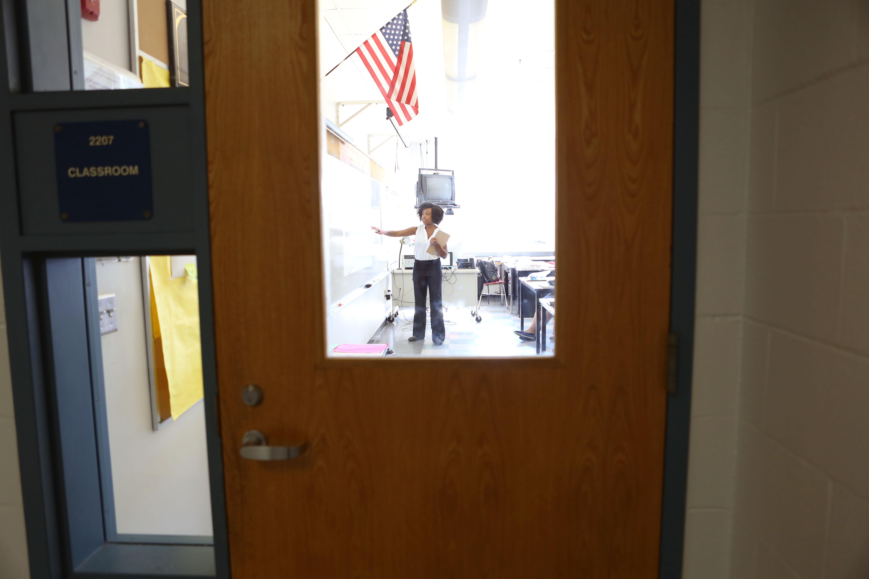 Teacher glimpsed through classroom door