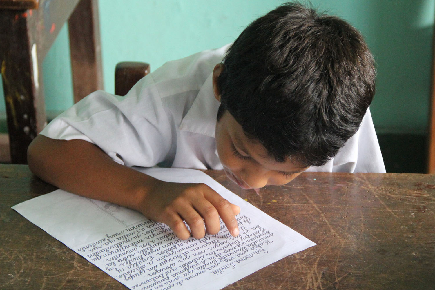 Peruvian student at desk reading