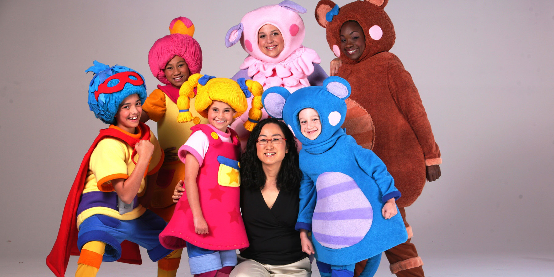 Sona Jho with characters from Mother Goose Club