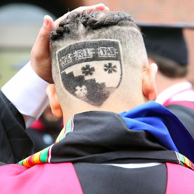 Graduate with crest shaved in his hair