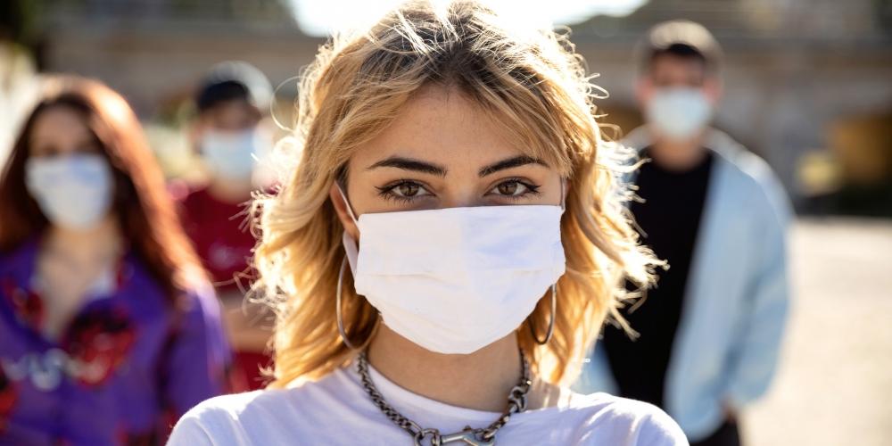 Teen in mask