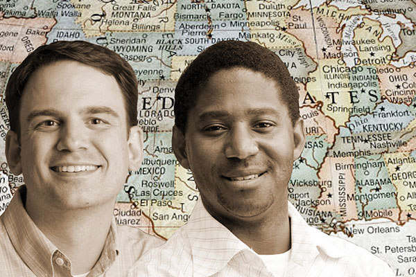 Ryan Wise and Ryan Stewart in front of U.S. map
