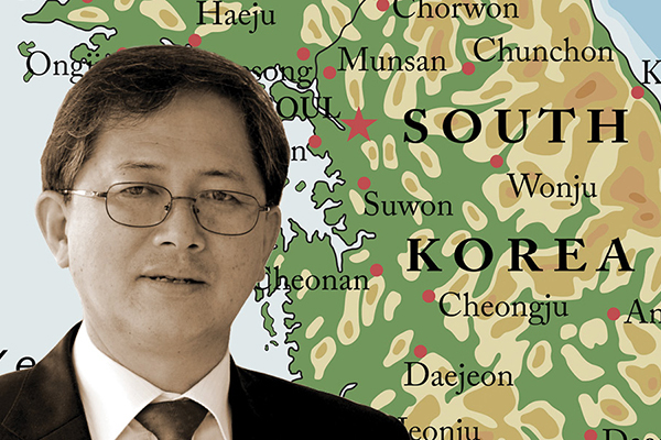 Gwang-Jo Kim in front of a map of South Korea