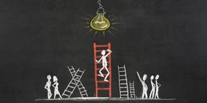 sketch on blackboard of stick figure climbing ladder