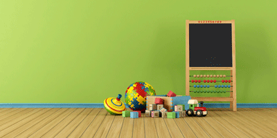An easel and toys in an early education classroom
