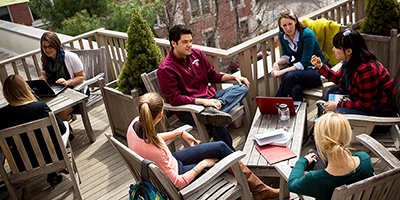 Students working together on outdoor terrace