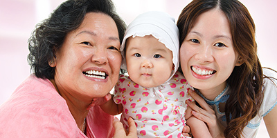 Multigenerational family with grandmother, infant, and mother