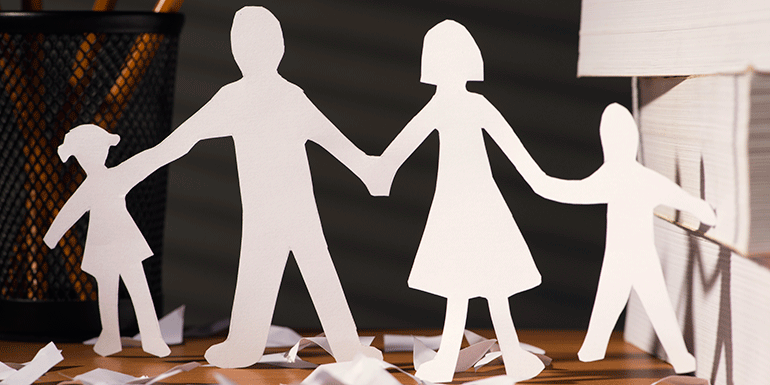 A paper cutout of a family