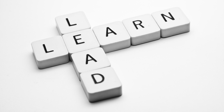 scrabble pieces that say Learn and lead