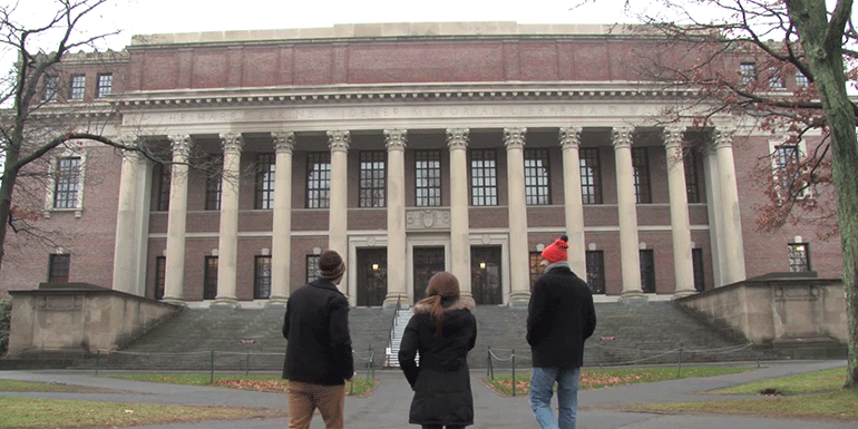 three students in front of widener library