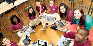 Liz Byron's students model their new laptops