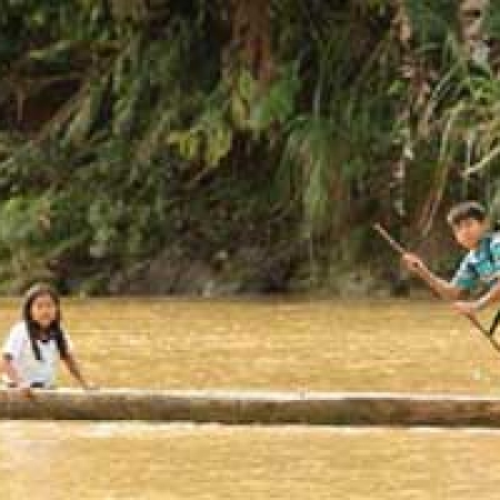 Two Amazon children in kayak