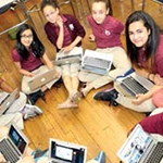 Liz Byron's students model their new laptops