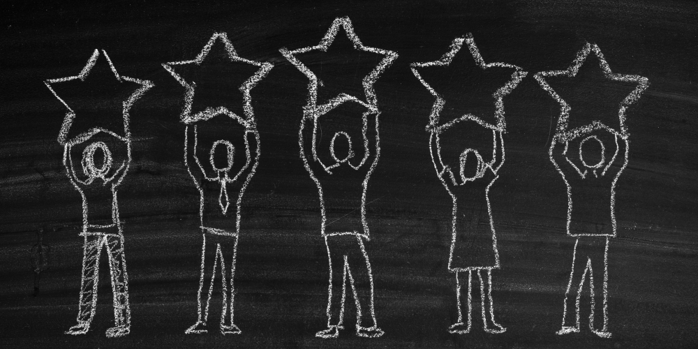 Chalkboard drawing of people holding stars