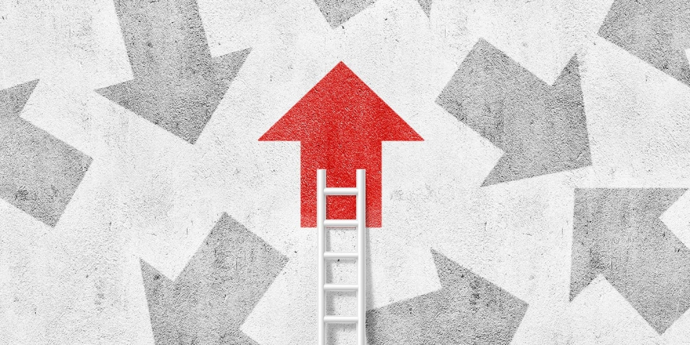 Red arrow at the top of a ladder
