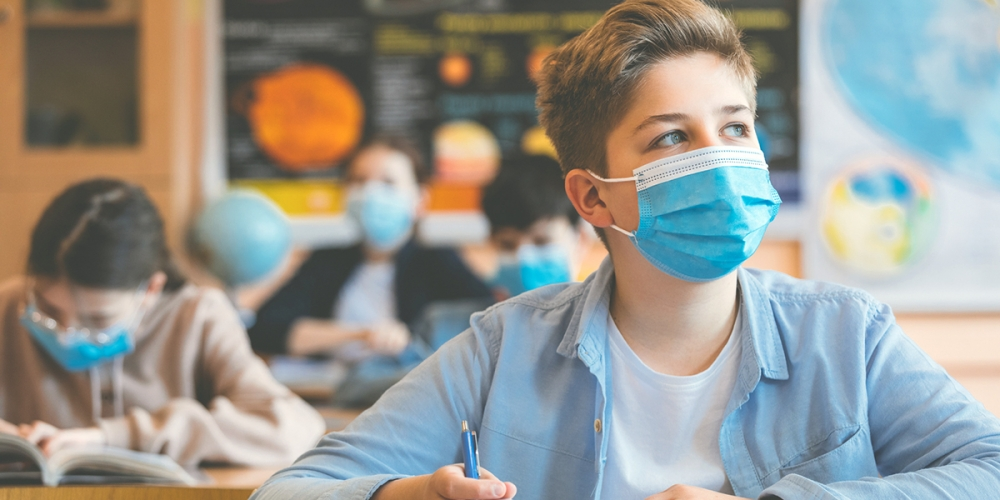 Student with facemask in classroom