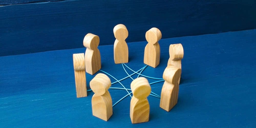 Wood figures in circle connected with string