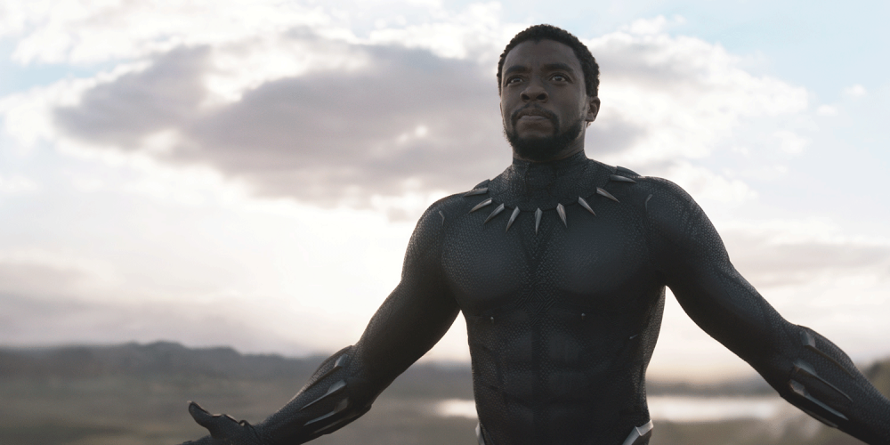 Black Panther character with mask off, against open sky