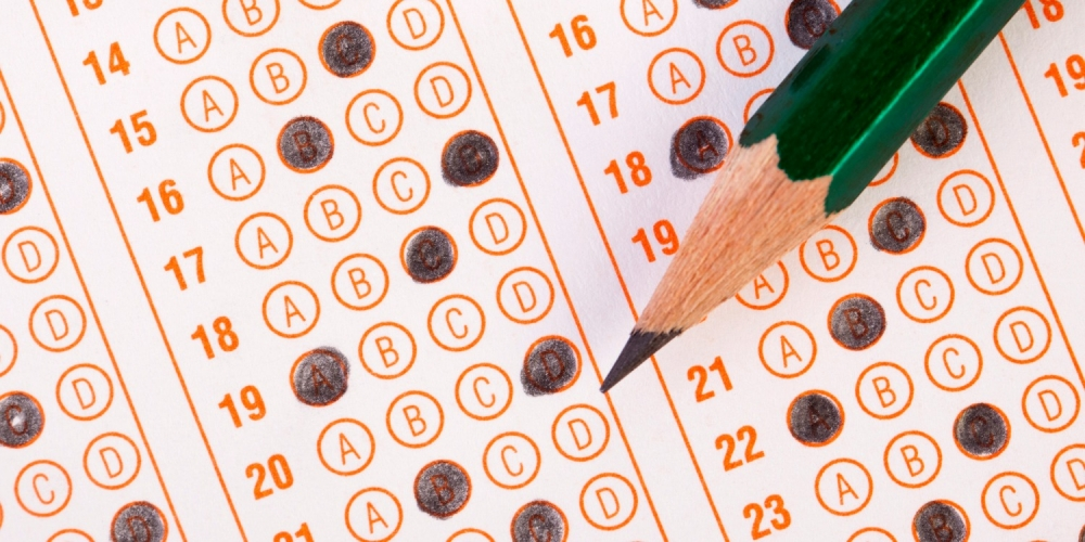 close-up of a pencil and a standardized test sheet