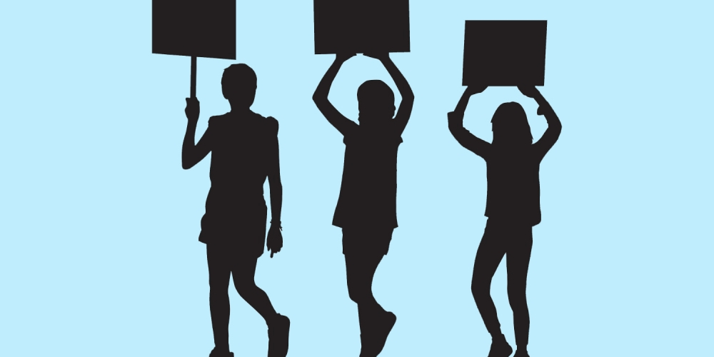 silhouettes of three young teen students holding signs