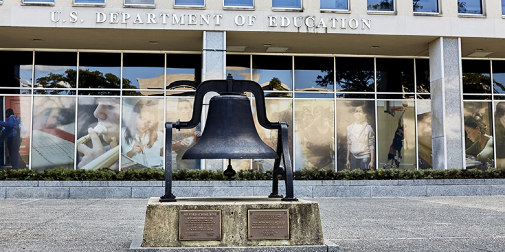 US Department of Education exterior, with old school bell in front