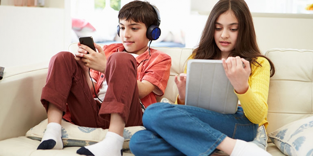 Boy and girl with digital devices