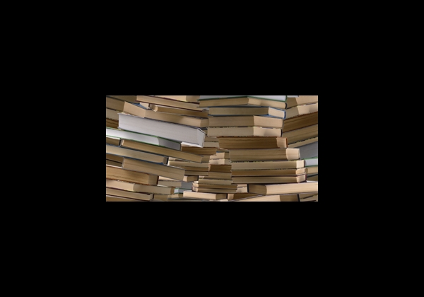 a photo of books piled up