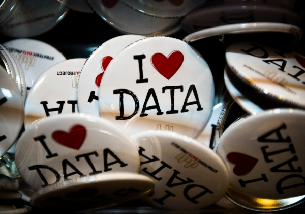 "lapel pins reading ""I heart data"""