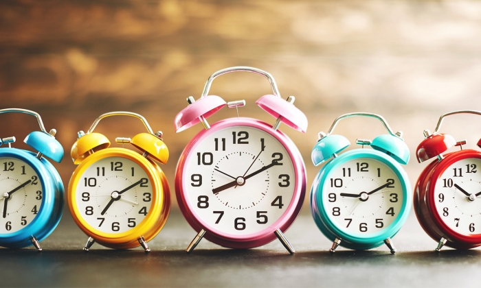 Line of alarm clocks telling different times