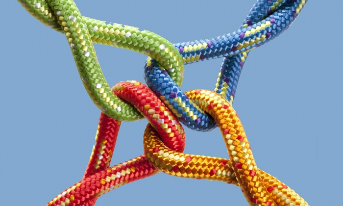Bright-colored knots joined at the center