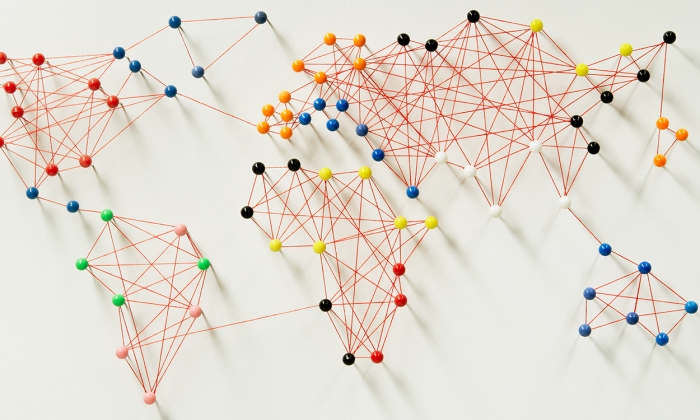Pins and string making a map of the world