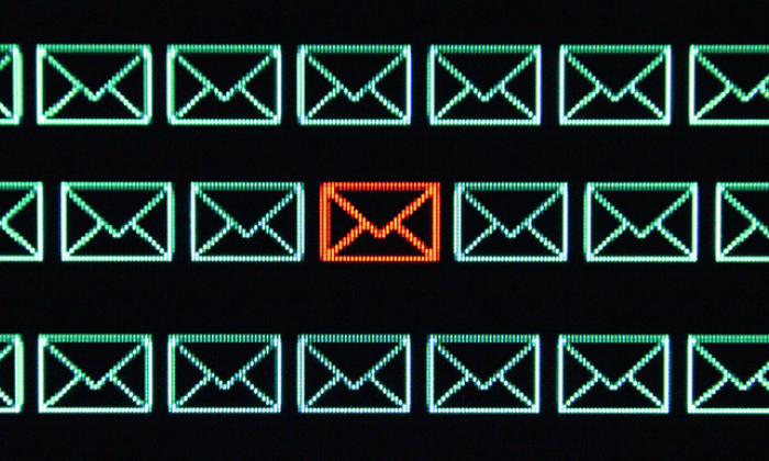 computerized image of many green email icons with one red icon