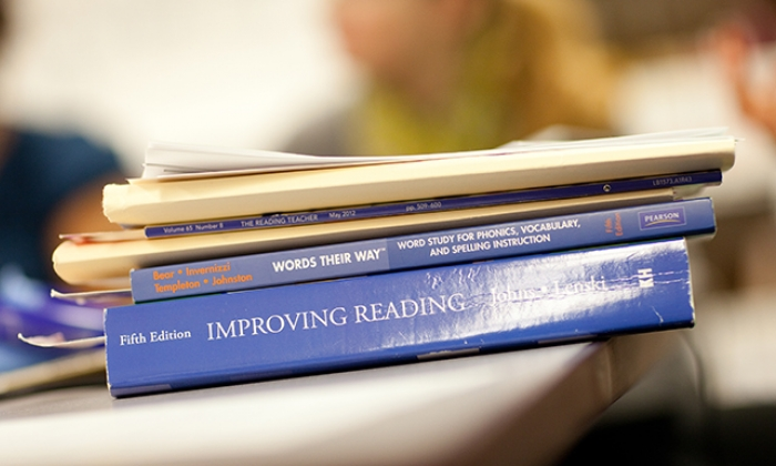 Literacy textbooks stacked on a desk