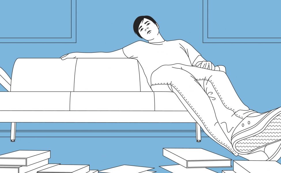 Teen lounging on couch with books on floor