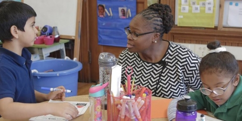 Mona Ford Walker with a student at Winship Elementary