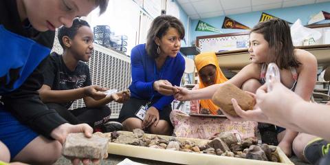 Rhoda Mhiripiri-Reed in a classroom with children