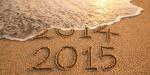 photo of a beach with 2014 and 2015 written in sand