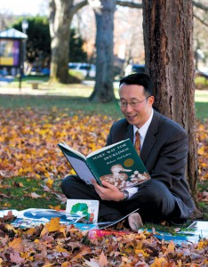 James Kim reads under a tree.