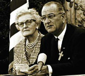 President Lyndon B. Johnson, with his childhood schoolteacher, Ms. Kate Deadrich Loney, prepares to sign ESEA into law. (Photo: Frank Wolf, courtesy of LBJ Library)